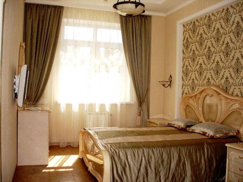 Как можно красиво сделать дизайн в спальню обоями, фото-идея
