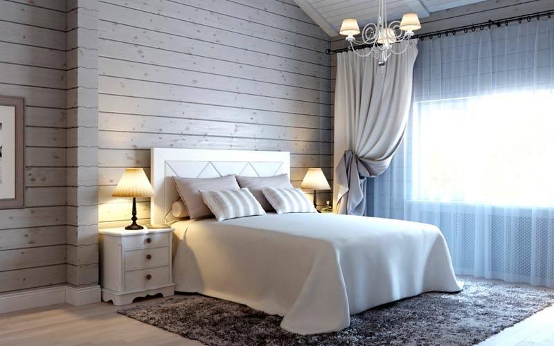 На фото спальня в деревянном доме в светлой цветовой гамме