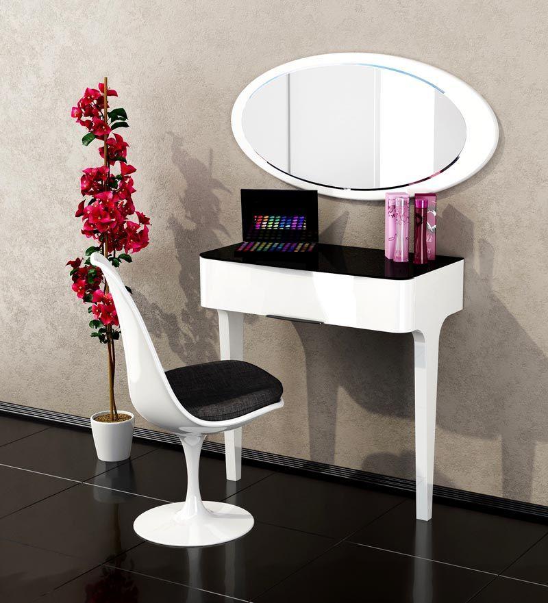 Такой косметический столик займет совсем немного месте и подойдет для минималистического стиля
