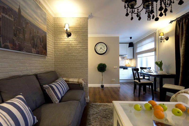 Всего одна стена, стилизованная под крашеный кирпич, придаст квартире налёт богемности