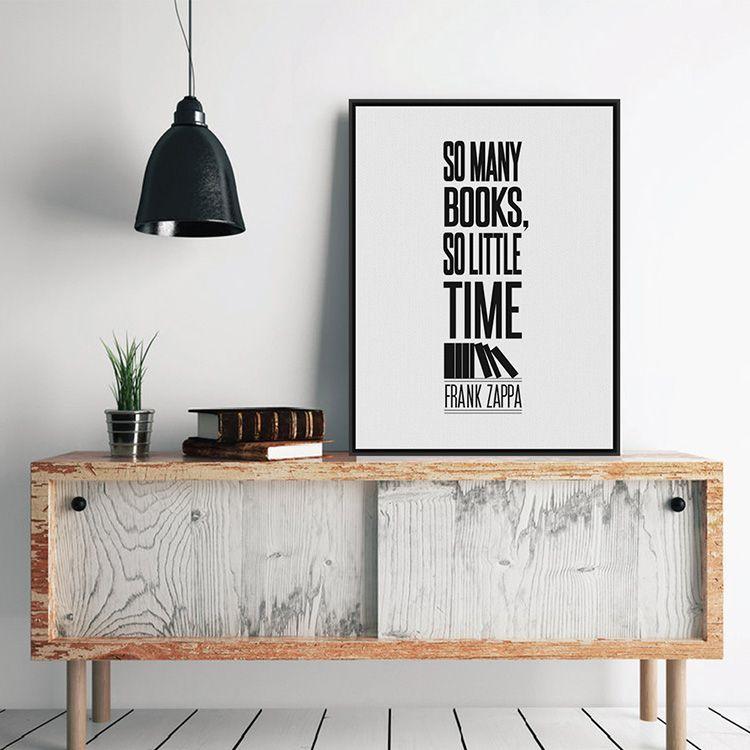 Чёрно-белый постер в рамке на тумбе
