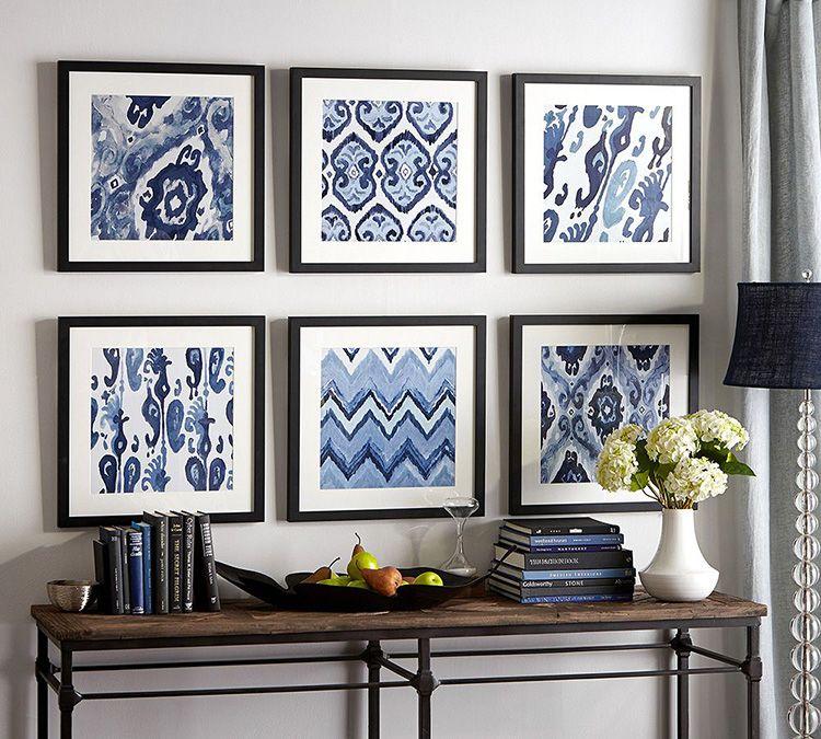Симметрия – наиболее популярный вариант размещения рамок на стене