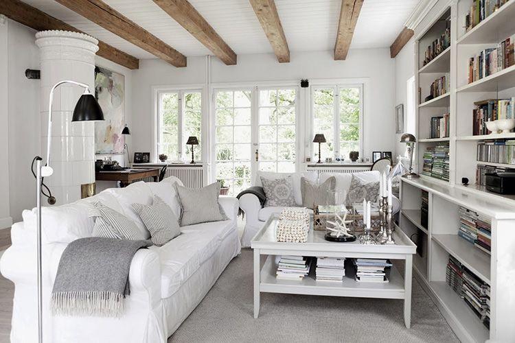 Белый цвет визуально приподнимает потолок