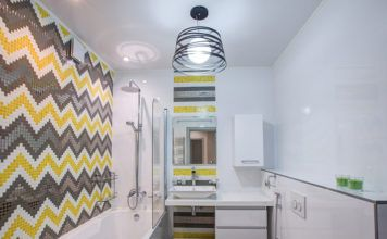 Уникальность в каждом изгибе, или почему и какие выбирают натяжные потолки в ванной комнате