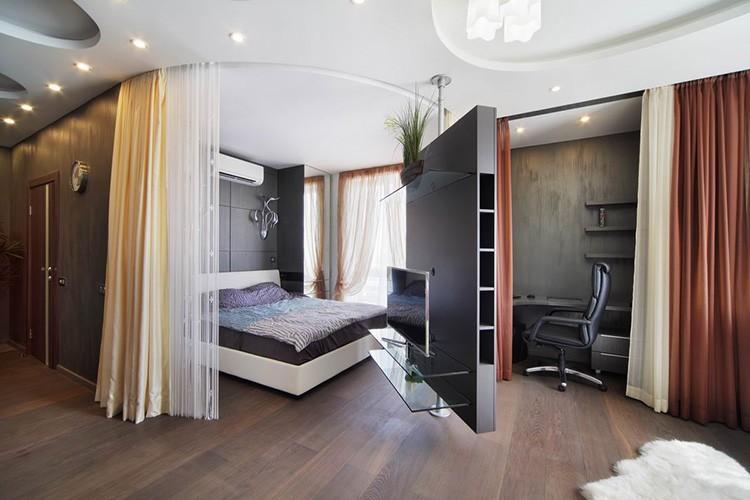 Зонирование комнаты при помощи вращающейся функциональной перегородки
