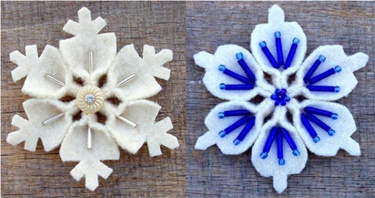 Интересные снежинки из одинаковых элементов с узором на кончиках. Каждый элемент сминают около основания и сшивают с другими.