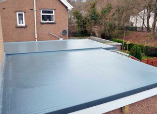 Секреты кровельного мастера: как организовать водосток на плоской крыше