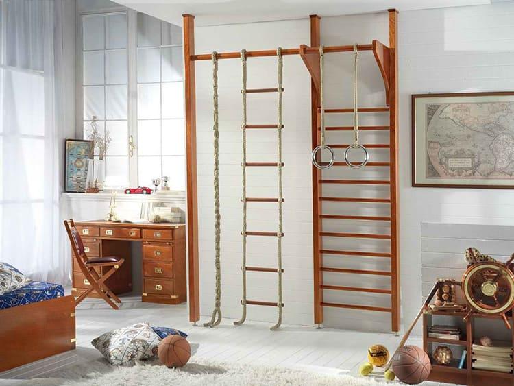 Несколько компактных тренажёров или просто шведская стенка с турников – это обязательно должно быть в его комнате