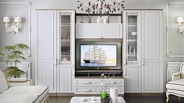 Белая деревянная мебель: хоть стиль не является современным, но игнорировать время он не может, поэтому в стенках для гостиных часто предусмотрена ниша под телевизор.