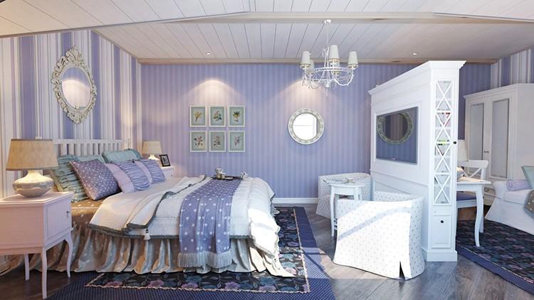 Спальни часто зонируют. И хорошо, если разделителем может послужить шкаф с нишей для телевизора.