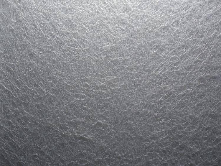 Тонкая и невесомая паутинка – стеклообои от Tassoglas – отличный материал для армирования потолка или стены