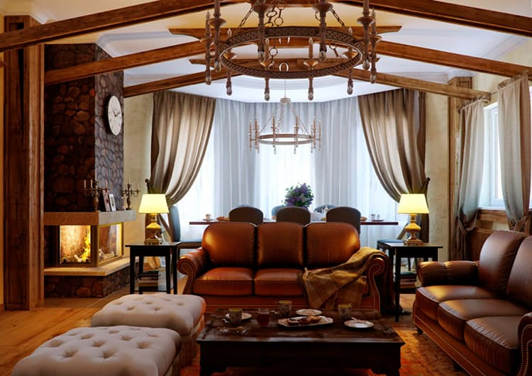 Кожаные диваны и большая центральная люстра – неотъемлемый атрибут гостиной в стиле кантри