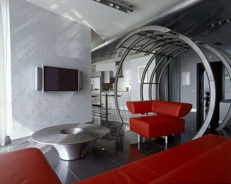 Красная мягкая мебель – прекрасный акцент, разбавляющий монохромную отделку