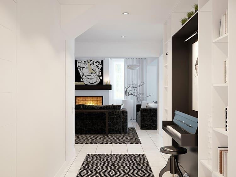 В гостиной расположились два больших дивана, небольшой стол – всё максимально аскетично