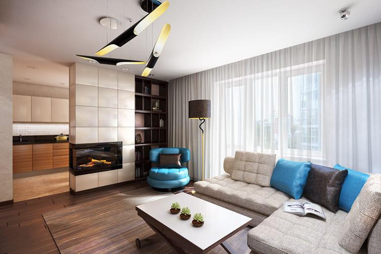 Использование осветительных приборов и камина для декорирования гостиной ФОТО: studio-may.com