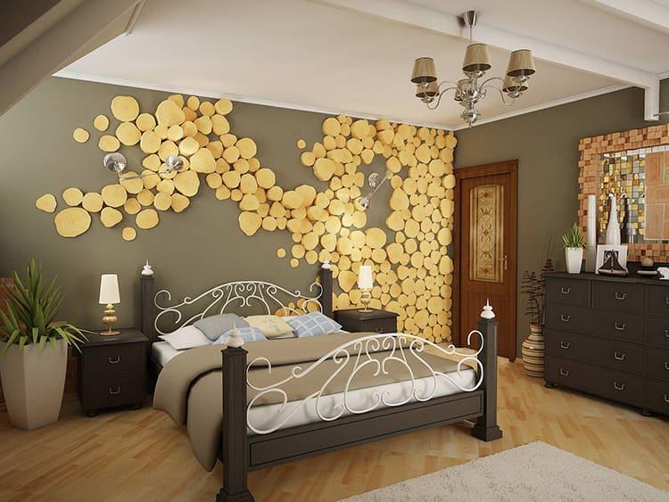 Главная акцентная стена в спальне – у изголовья кровати. Её оформление может быть самым разнообразным: отФОТОобоев до необычных панно, вроде этих древесных спиловФОТО: elitdom.com.