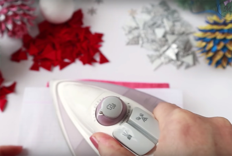 Накройте фом листом бумаги и прогладьте слегка разогретым утюгом