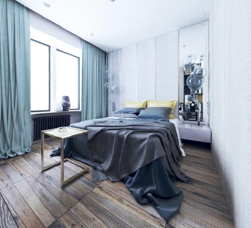 Строгий интерьер разбавляют декоративные подушки жёлтого цвета и оригинальный столик в золотом металлическом каркасе