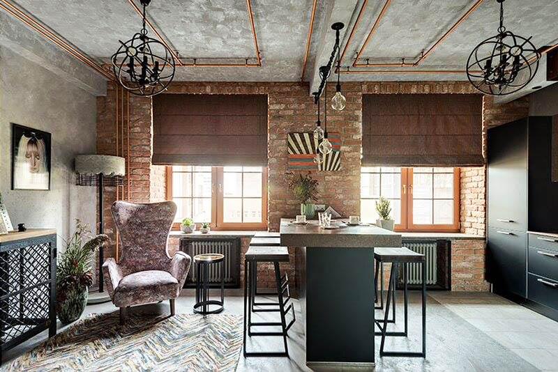 Пёстрый коврик в зоне отдыха и портрет хозяйки эффектно дополнили интерьер кухни-столовой