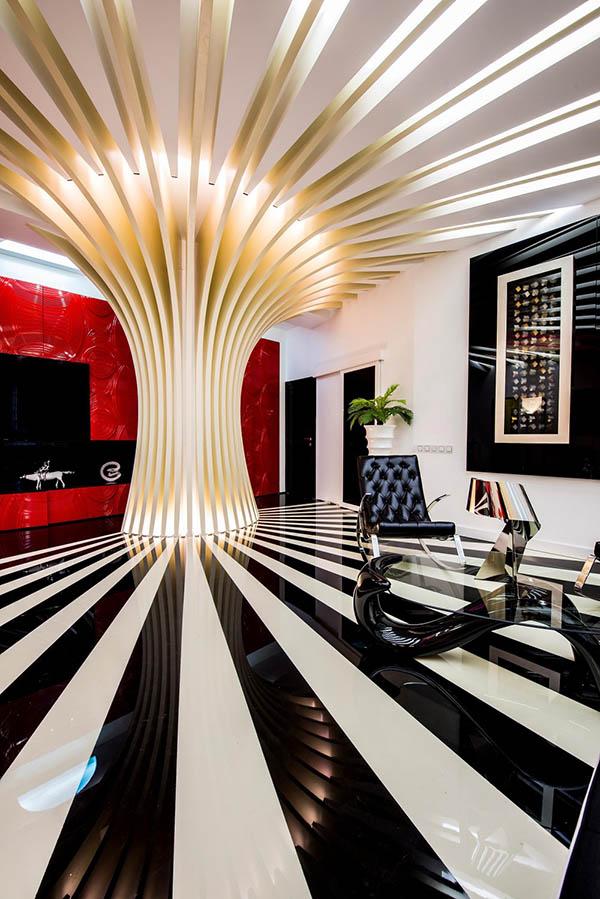 Очертания мебели повторяют линии арт-объекта в гостиной