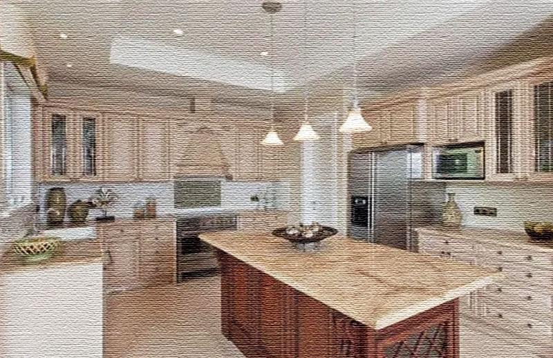 Кухонную зону освещают точечные светильники и ряд элегантных подвесных ламп с матовыми абажурами