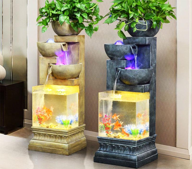 Шикарно выглядят аквариумы, в которых есть встроенный каскад или фонтан